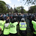 Security and police try to prevent supporters from entering a homeless encampment as the camp's occupants await possible eviction by police after workers enclosed the area with a fence, at Trinity Bellwoods Park in Toronto, June 22, 2021.