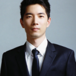 portrait of Yuan Hsiao against a light gray background