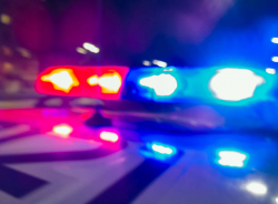 police car lights flashing red and blue