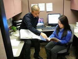 Sociology students Johnny Luu and Anna Son prepare for a presentation