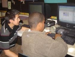 Chan Saelee tutors a student