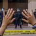 A demonstrator holds their hands up while they kneel in front of the police at the Anaheim City Hall on June 1, 2020 in Anaheim, California, during a peaceful protest over the death of George Floyd. (Apu Gomes/AFP/Getty Images)
