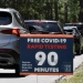 People in cars wait at a Covid testing and vaccination site at Barnett Park in Orlando, Florida